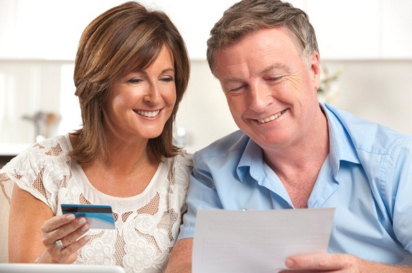 Mature couple looking at credit card statement