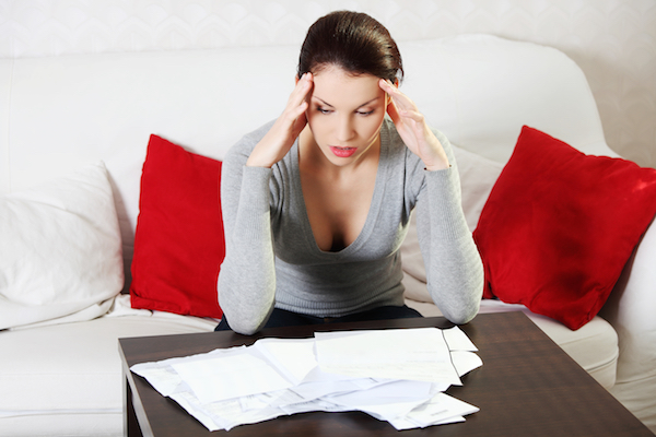 Woman Stressing About Debt