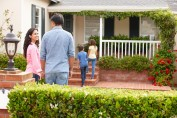 Hispanic family outside home for rent