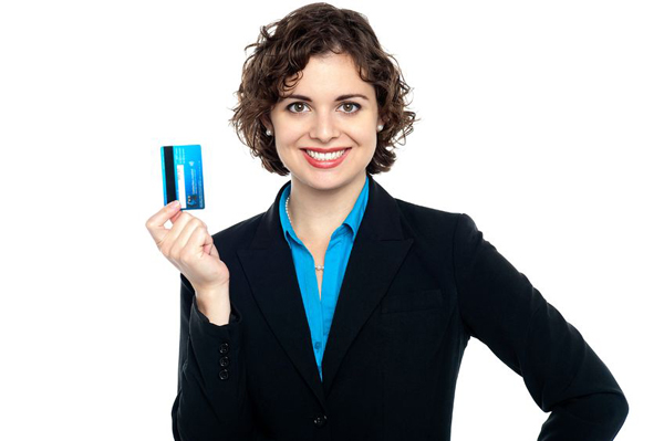 Reasons to get a business credit card credit sesame smiling businesswoman holding a credit card colourmoves