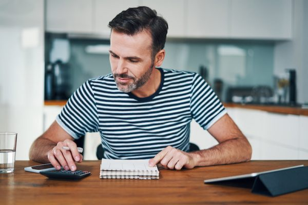 what is a credit report - man looking at credit report on tablet